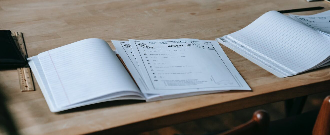 opened copybooks placed on school bench