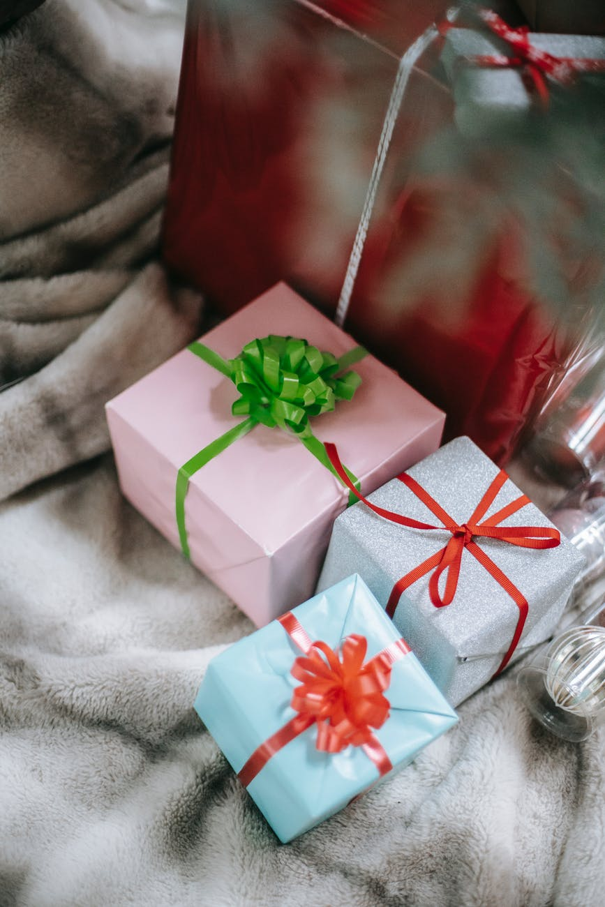 christmas presents wrapped in paper and ribbon